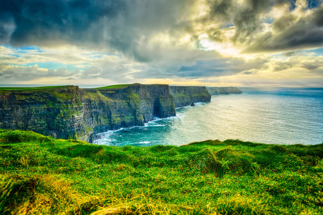 Cliffs of Moher, County Clare, Ireland, The Burren, Europe are one of Ireland's top touristic attractions. The maximum height of Cliffs is 214 m, lenght 8 km. HDR processing.